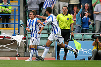 Football<br /> Coca Cola Football League One<br /> Brighton and Hove Albion vs Wycombe Wanderers at The Withdean Stadium, Brighton<br /> Brighton's Dean Cox is congratulated by team mates after setting up Nicky Forster to score <br /> 05/09/2009<br /> Credit Colorsport / Shaun Boggust