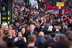 "London, December 23rd 2014. Dubbed by retailers as the ""Golden Hour"" thousands of shoppers use their lunch hour to do some last minute Christmas shopping in London's West End. PICTURED: Dense crowds on Oxford Street do their last-minute Christmas shopping."