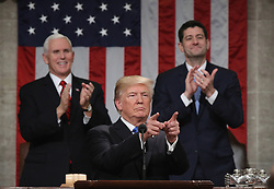 January 30, 2018 - Washington, District of Columbia, United States of America - WASHINGTON, DC - JANUARY 30:  U.S. President Donald J. Trump waves during the State of the Union address as U.S. Vice President Mike Pence (L) and Speaker of the House U.S. Rep. Paul Ryan (R-WI) (R) look on in the chamber of the U.S. House of Representatives January 30, 2018 in Washington, DC. This is the first State of the Union address given by U.S. President Donald Trump and his second joint-session address to Congress. .Credit: Win McNamee / Pool via CNP (Credit Image: © Win Mcnamee/CNP via ZUMA Wire)