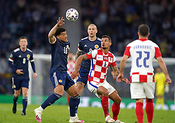 Scotland's Che Adams (left) and Croatia's Dejan Lovren battle for the ball during the UEFA Euro 2020 Group D match at Hampden Park, Glasgow. Picture date: Tuesday June 22, 2021.