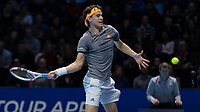 Tennis - 2019 Nitto ATP Finals at The O2 - Day One<br /> <br /> Singles Group Bjorn Borg: Roger Federer (Switzerland) vs. Dominic Thiem (Austria)<br /> <br /> Dominic Thiem (Austria) with a forehand return <br /> <br /> COLORSPORT/DANIEL BEARHAM