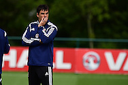 Chris Coleman, the Wales manager looks on during Wales football team training at the Vale Resort, Hensol near Cardiff, South Wales on Monday 8th June 2015. The Wales team are preparing for their forthcoming Euro 2016 qualifying match against Belgium.<br /> pic by Andrew Orchard, Andrew Orchard sports photography.