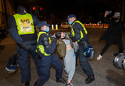 """© Licensed to London News Pictures;03/04/2021; Bristol, UK. A woman is arrested at a fifth """"Kill the Bill"""" protest in a fortnight taking place in Bristol against the Police, Crime, Sentencing and Courts Bill during the Covid-19 coronavirus pandemic in England. The Bill proposes new restrictions on protests. Some previous Kill the Bill protests in Bristol had violence. Photo credit: Simon Chapman/LNP."""