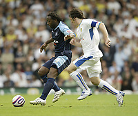 Photo: Aidan Ellis.<br /> Leeds United v Swansea City. Coca Cola League 1. 22/09/2007.<br /> Swansea's Jason Scotland battles with Leeds Johnathon Douglas