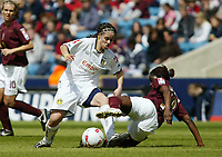 Photo: Chris Ratcliffe.<br /> Leeds United v Arsenal. Womens' FA Cup Final. 01/05/2006.<br /> Nicole Emmanuel (L) of Leeds beats Mary Phillip of Arsenal to the ball.