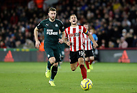 SHEFFIELD, ENGLAND - DECEMBER 05: <br /> Newcastle United's Paul Dummett chases with Sheffield United's Billy Sharp during the Premier League match between Sheffield United and Newcastle United at Bramall Lane on December 5, 2019 in Sheffield, United Kingdom. (Photo by Rich Linley - CameraSport via Getty Images)