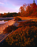 Sunset light illuminating the mouth of the Sand River along the shore of Lake Superior, Lake Superior Provicial Park, Ontario, Canada.