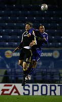 Photo: Steve Bond.<br />Leicester City v Cardiff City. Coca Cola Championship. 26/11/2007. Glenn Loovens (L) in an aeriel challange with Iain Hume (R)