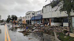 October 10, 2018 - Port St. Joe, Florida, U.S. - Port St. Joe Lodge number 111, at right, lay in ruins on Reid Avenue on Wednesday afternoon after Hurricane Michael made landfall in the Florida Panhandle. Hurricane Michael formed off the coast of Cuba carrying major Category 4 landfall in the Florida Panhandle. Surge in the Big Bend area, along with catastrophic winds at 155mph. (Credit Image: © Douglas R. Clifford/Tampa Bay Times via ZUMA Wire)