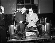 15/10/1952<br /> 10/15/1952<br /> 15 October 1952<br /> P.J. Carroll and Co. Ltd tobacco factory, Dundalk. Visit of Sean MacEntee, Minister for Finance to the Factory.  Picture shows Mr. M. Kerley, Factory Manager giving the Minister  a tour of the factory.