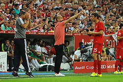 05.08.2015, Allianz Arena, Muenchen, GER, AUDI CUP, FC Bayern Muenchen vs Real Madrid, im Bild Thomas Mueller (FC Bayern Muenchen) spritzt einen Betreuer nass. Bildmitte Trainer Pep Guardiola (FC Bayern Muenchen) // during the 2015 Audi Cup Match between FC Bayern Munich and Real Madrid at the Allianz Arena in Muenchen, Germany on 2015/08/05. EXPA Pictures © 2015, PhotoCredit: EXPA/ Eibner-Pressefoto/ Stuetzle<br /> <br /> *****ATTENTION - OUT of GER*****