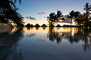 Sunset shot of the infinity pool at the Bora Bora Nui Resort & Spa. Previously a Starwood Luxury Collection property, the Bora Bora Nui is now operated by Hilton. Bora Bora is one of the Leeward Islands in the Society Islands archipelago of French Polynesia.