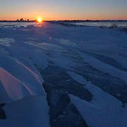 The sun sets over an unnamed lake near Churchill, Manitoba, Canada. Winter.