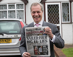 © Licensed to London News Pictures. 23/06/2016. Biggin Hill, UK. UKIP party leader Nigel Farage is seen at home with a copy of the Daily Mail newspaper before voting in the EU referendum. Polls have opened for voting - with counting starting after polls close at 10PM.Photo credit: Peter Macdiarmid/LNP