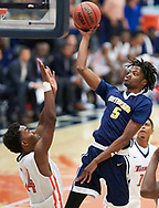 Jamelle Holieway Jr (#5) of the Bethesda  Flames dunks during a game against Cal State Fullerton's Titans on Friday, November 7,  2015.<br /> <br /> Mandatory Copyright Notice: Copyright 2015 (Photo by Sarah Sachs) Mandatory Copyright Notice: Copyright 2015 (Photo by Sarah Sachs)