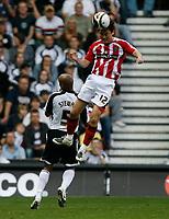 Photo: Steve Bond/Richard Lane Photography. Derby County v Sheffield United. Coca-Cola Championship. 13/09/2008. Sun Jihai (R) gets well above Jordan Stewart