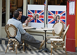 © licensed to London News Pictures.  28/04/2011. The Royal Wedding of HRH Prince William to Kate Middleton. Cafe Diana on Notting Hill Gate which pays homage to the Princess of Wales prepares for the Royal Wedding tomorrow. See special instruction for rates. Photo  credit should read LNP.