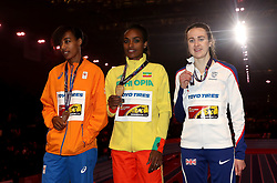 Ethiopia's gold medal winner Genzebe Dibaba (centre), Great Britain's silver medal winner Laura Muir (right) and Netherland's bronze winner Sifan Hassan (left) after the 1500m Final during day three of the 2018 IAAF Indoor World Championships at The Arena Birmingham.