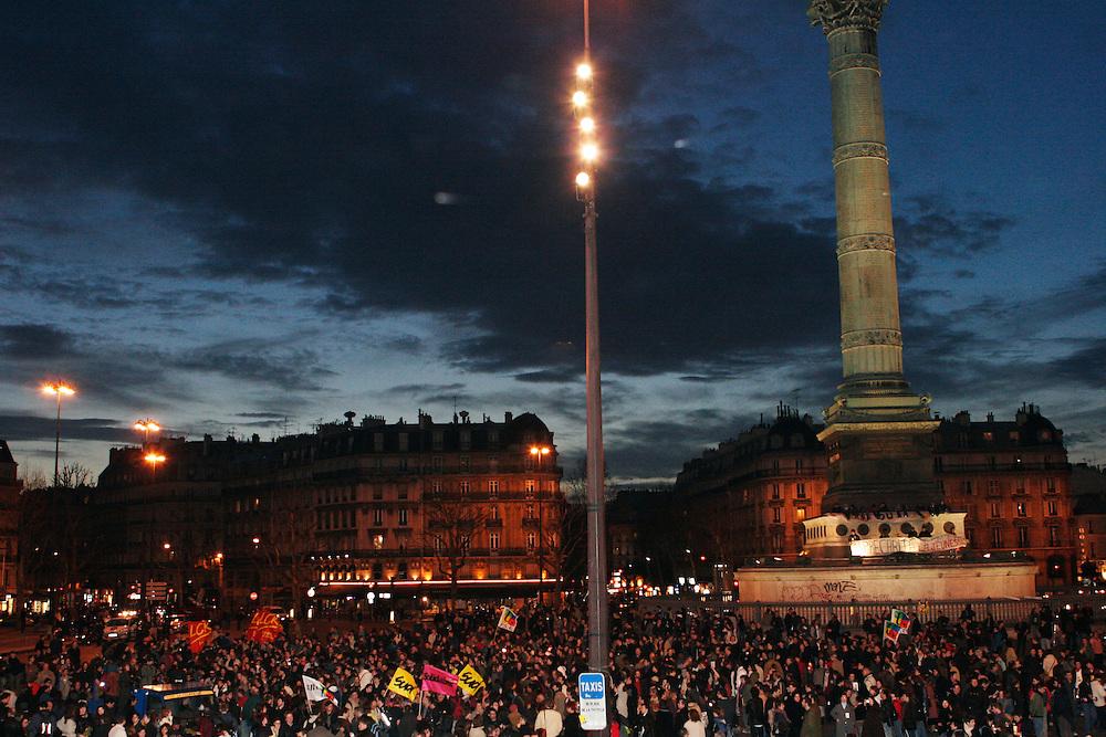 Place de la Bastille, Paris, France. March 31st 2006..Students against the government's controversial youth employment laws, known as CPE, gather at Place de la Bastille to listen to Jacques Chirac's speech.