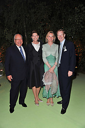 Left to right, URS & FRANCESCA SCHWARZENBACH and the EAL & COUNTESS OF DERBY at a dinner hosted by Cartier in celebration of the Chelsea Flower Show held at Battersea Power Station, 188 Kirtling Street, London SW8 on 23rd May 2011.