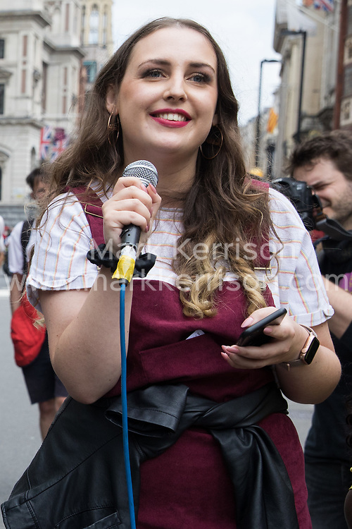 London, UK. 29th May, 2021. A speaker addresses activists from civil rights and other groups outside the Royal Courts of Justice during a Kill The Bill National Day of Action in protest against the Police, Crime, Sentencing and Courts (PCSC) Bill 2021. The PCSC Bill would grant the police a range of new discretionary powers to shut down protests, including the ability to impose conditions on any protest deemed to be disruptive to the local community, wider stop and search powers and sentences of up to 10 years in prison for damaging memorials.
