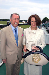 The French ambassador to the UK GERARD ERRERA & MRS ERRERA at the Queen's Cup polo final sponsored by Cartier at Guards Polo Club, Smith's Lawn, Windsor Great Park on 18th June 2006.  The Final was between Dubai and the Broncos polo teams with Dubai winning.<br /><br />NON EXCLUSIVE - WORLD RIGHTS