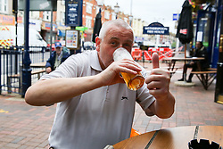© Licensed to London News Pictures. 04/07/2020. London, UK. A man has a drink and gives a thumbs up at THE TOLL GATE, a Wetherspoon pub in north London which reopened on Super Saturday. Cafes, restaurants, pubs and hairdressers across the UK closed on 23 March following the coronavirus lockdown. As restrictions are eased, cafes, restaurants, pubs and hairdressers reopens today. Photo credit: Dinendra Haria/LNP
