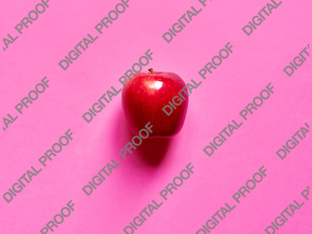 Red apple viewed from above over a fuschia background isolated in studio
