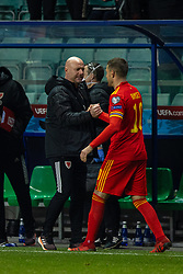 TALLINN, ESTONIA - Monday, October 11, 2021: Wales' manager Robert Page (L) celebrates with captain Aaron Ramsey after the FIFA World Cup Qatar 2022 Qualifying Group E match between Estonia and Wales at the A. Le Coq Arena. Wales won 1-0. (Pic by David Rawcliffe/Propaganda)