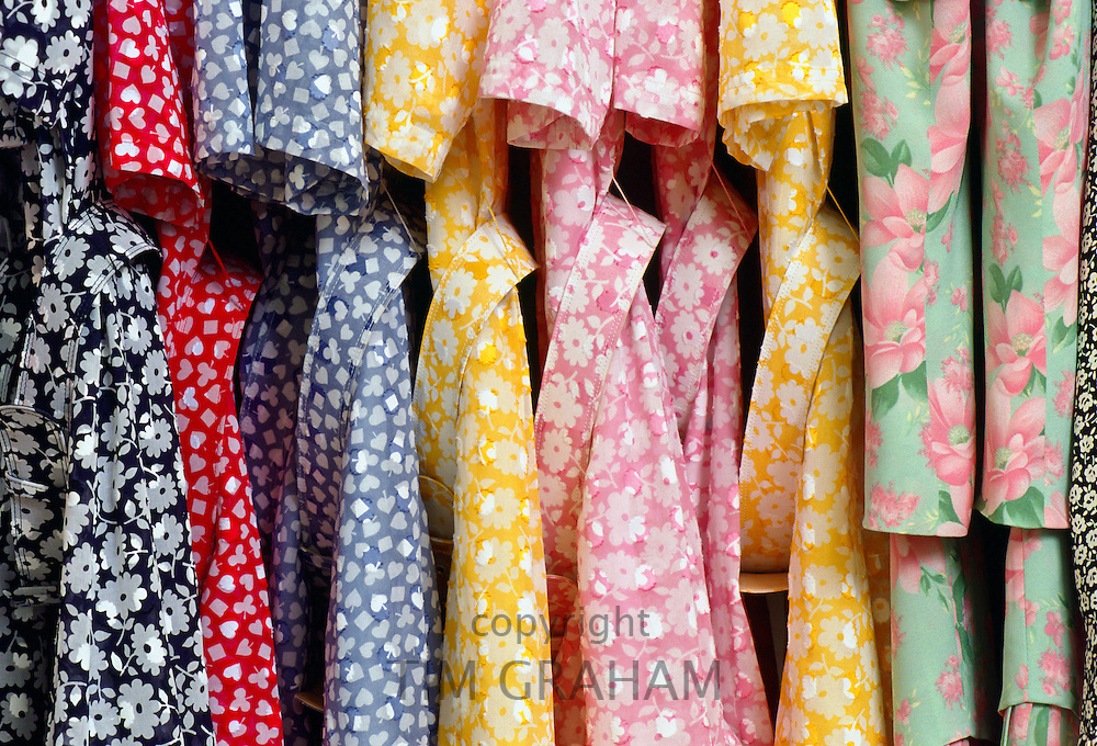 Dresses, designed by Hardy Amies, on a hanging rail at his London studio