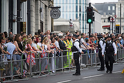 © Licensed to London News Pictures. 03/06/2018. London, UK. Members of the public line the streets for a minutes silence for the victims of the 2017 London Bridge Terror attack, held on London Bridge. Eight people were killed and 48 were injured when a van was deliberately driven into pedestrians on London Bridge. Three occupants then ran to the nearby Borough Market area carrying knives and fake explosives. Photo credit: Ben Cawthra/LNP