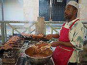18 JUNE 2015 - PATTANI, PATTANI, THAILAND:   A Muslim man cooks barbecued chicken in the Pattani Ramadan Bazaar. People come to the street food market late in the day to buy meals for the evening Iftar meal, which breaks the day long fast. Ramadan is the ninth month of the Islamic calendar, and is observed by Muslims worldwide as a month of fasting to commemorate the first revelation of the Quran to Muhammad according to Islamic belief. This annual observance is regarded as one of the Five Pillars of Islam. Islam is the second largest religion in Thailand. Pattani, along with Narathiwat and Yala provinces, all on the Malaysian border, have a Muslim majority.       PHOTO BY JACK KURTZ