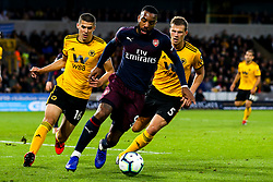 Alexandre Lacazette of Arsenal takes on Ryan Bennett of Wolverhampton Wanderers and Conor Coady of Wolverhampton Wanderers - Mandatory by-line: Robbie Stephenson/JMP - 24/04/2019 - FOOTBALL - Molineux - Wolverhampton, England - Wolverhampton Wanderers v Arsenal - Premier League