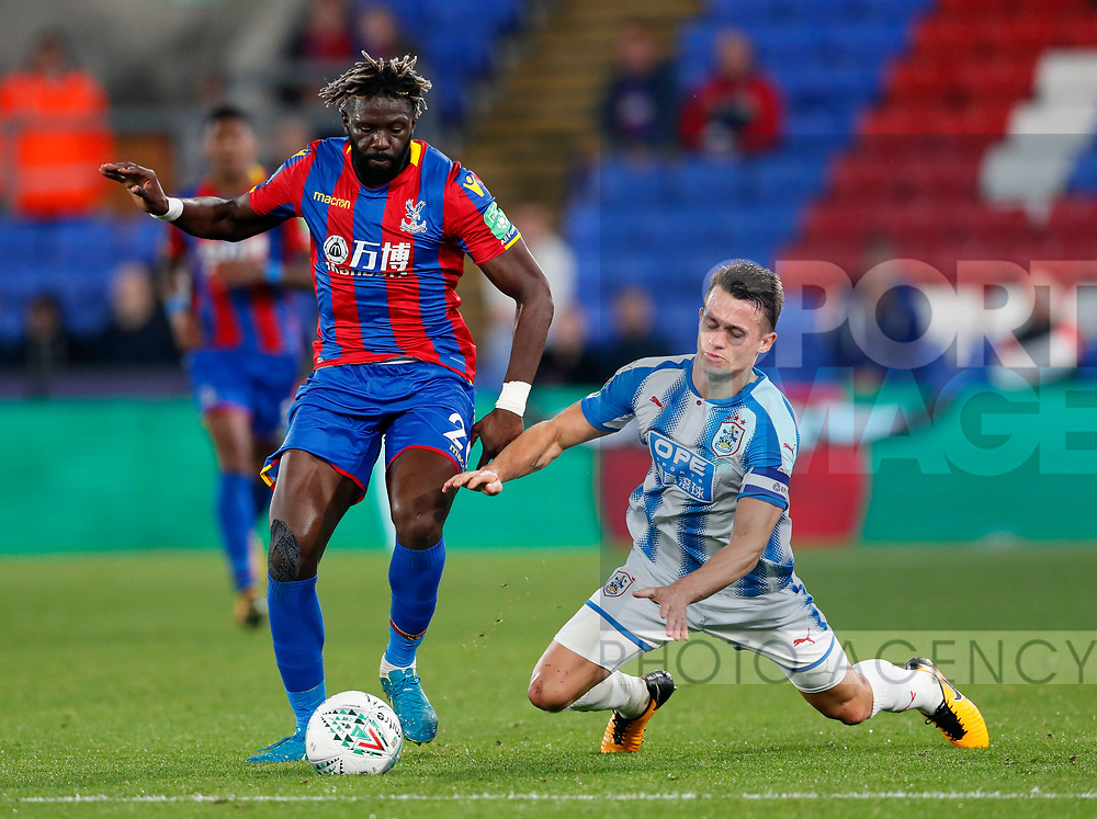 Crystal Palace's Bakary Sako tussles with Huddersfield's Jonathan Hogg during the Carabao cup match at Selhurst Park Stadium, London. Picture date 19th September 2017. Picture credit should read: David Klein/Sportimage