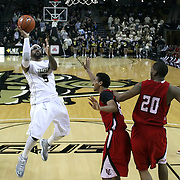 Central Florida guard Marcus Jordan (5) drives to the net against Louisville at the UCF Arena on December 15, 2010 in Orlando, Florida. UCF won the game79-58. (AP Photo/Alex Menendez)