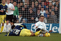 Photo: Kevin Poolman.<br />Luton Town v Derby County. Coca Cola Championship. 18/11/2006. Luton's Ahmet Berkovic and Giles Barnes of Derby go in for the tackle.