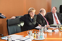 14 JAN 2014, BERLIN/GERMANY:<br /> Angela Merkel, CDU, Budneskanzlerin, setzt sich auf Ihren Platz, vor Beginn der Kabinettsitzung, Bundeskanzleramt<br /> IMAGE: 20150114-01-028<br /> KEYWORDS: Sitzung, Kabinett