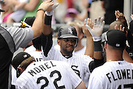CHICAGO - JULY 27:  Alexei Ramirex #10 of the Chicago White Sox celebrates with teammates in the dugout during the game against Detroit Tigers on July 27, 2011 at U.S. Cellular Field in Chicago, Illinois.  The White Sox defeated the Tigers 2-1.  (Photo by Ron Vesely)  Subject: Alexei Ramirez