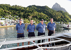 Members of the Crew of RFA Waveknight stand to attention as Prince Harry arrives in Soufriere on the island of St Lucia during the second leg of his Caribbean tour.