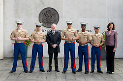 Secretary of Defense Jim Mattis and Laura Lochman, the deputy chief of mission at the U.S. Embassy in Denmark, pose for a photo with U.S. Marines in Copenhagen, Denmark, May 8, 2017. (DOD photo by U.S. Air Force Staff Sgt. Jette Carr)