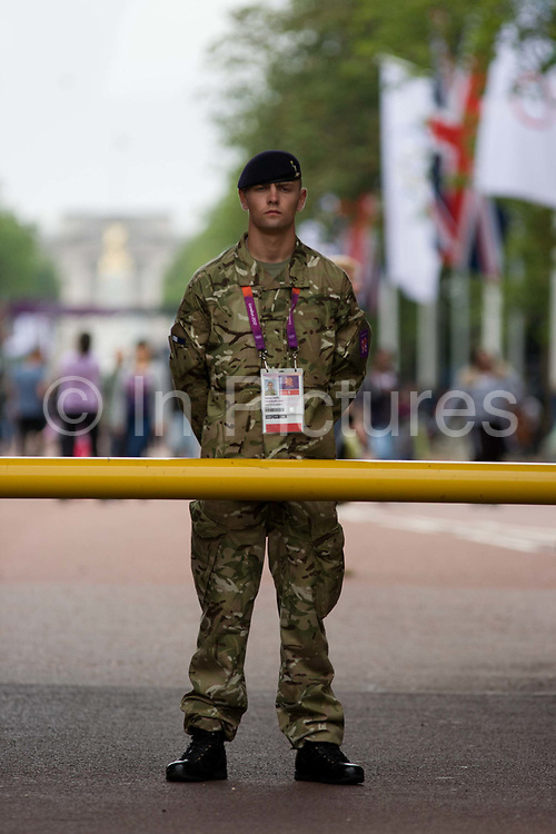 A soldier of the British army stand guarding the entrance to the volleyball venue in central London next to the IOC rings logo on day 4 of the London 2012 Olympic Games. A further 1,200 military personnel are being deployed to help secure the 2012 Olympics in London following the failure by security contractor G4S to provide enough private guards. The extra personnel have been drafted in amid continuing fears that the private security contractor's handling of the £284m contract remains a risk to the Games.