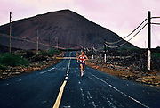 An Englishman with a Union Jack Tshirt running some of the 35miles of road, 27th May 1997, on Ascension, a small area of approximately 88 km² isolated volcanic island in the equatorial waters of the South Atlantic Ocean, roughly midway between the horn of South America and Africa. It is governed as part of the British Overseas Territory of Saint Helena, Ascension and Tristan da Cunha. Organised settlement of Ascension Island began in 1815, when the British garrisoned it as a precaution after imprisoning Napoleon I on Saint Helena. In January 2016 the UK Government announced that an area around Ascension Island was to become a huge marine reserve, to protect its varied and unique ecosystem, including some of the largest marlin in the world, large populations of green turtle, and the islands own species of frigate bird. With an area of 234,291 square kilometres 90,460 sq mi, slightly more than half of the reserve will be closed to fishing.