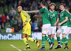 Republic of Ireland's Darren Randolph is congratulated by team-mates after making a save during the International Friendly at The Aviva Stadium, Dublin.