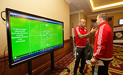 NEWPORT, WALES - Sunday, May 22, 2016: Thierry Henry chats with first-team development coach Pepijn Lijnders about Globall Coach during the Football Association of Wales' National Coaches Conference 2016 at Dragon Park FAW National Development Centre. (Pic by David Rawcliffe/Propaganda)