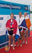 Belgrade, SERBIA,  A Finals Women's single sculls medals. left,  Silver medalist NED W1X, Chantel ACTERBURG, middle, Gold Medalist CZE W1X, Mirka KNAPKOVA and Right bronze medalist IRL W1X, Sanita PUSPUE at the  2014 FISA European Rowing Championships. Lake Sava. <br /> <br /> <br /> 14:45:12  Sunday  01/06/2014<br /> <br /> [Mandatory Credit; Peter Spurrier/Intersport-images]
