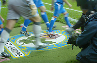 18/12/2004 - FA Barclays Premiership - Blackburn Rovers v Everton - Ewood Park<br />A TV cameraman film the Blackburn Rovers and Everton players as they come out onto the pitch and walk across the Blackburn crest on the carpet.<br />Photo:Jed Leicester/Back Page Images