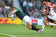 South Africa's Hooker Adrian Strauss dives for a try during the Rugby World Cup Pool B match between South Africa and Japan at the Community Stadium, Brighton and Hove, England on 19 September 2015. Photo by Phil Duncan.