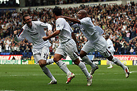 Photo: Paul Thomas.<br /> Bolton Wanderers v Liverpool. The Barclays Premiership. 30/09/2006.<br /> <br /> Bolton players Nicky Hunt (L) and El Hadji Diouf (R) celebrate Gary Speed's goal (6).