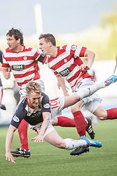 Falkirk's Craig Sibbald tackled by Hamilton's Lewis Longridge.<br /> Falkirk 1 v 1 Hamilton, Scottish Premiership play-off semi-final first leg, played 13/5/2014 at the Falkirk Stadium.