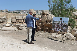 The Duke of Cambridge (left) and Crown Prince Hussein of Jordan look at a photo of the Duchess of Cambridge as a child, when she was photographed with her family at the same spot of the Jerash archaeological site in Jordan.